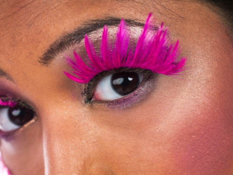 Model wearing pink false eyelashes