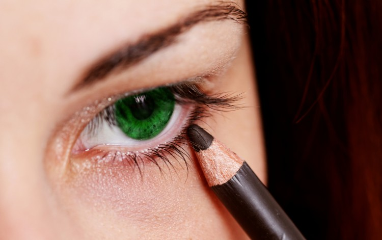 Young Woman Using Eyeliner